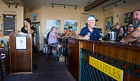 Happy hour at Pineapples restaurant, downtown Hilo, Big Island of Hawai'i.