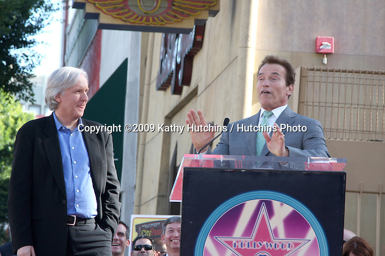 James Cameron & Arnold Schwarzenegger. at the Hollywood Walk of Fame Ceremony for James Cameron.Egyptian Theater Sidewalk.Los Angeles,  CA.December 18, 2009.©2009 Kathy Hutchins / Hutchins Photo.