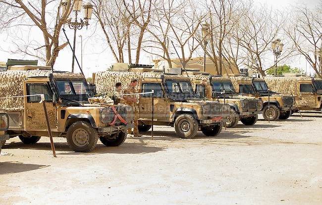 28/11/2012. FILE PICTURE 28/11/2012. British army 'Snatch' Land Rovers are seen lined up at Basra Palace in Basra, Iraq, in May 2005. Relatives of soldiers who were killed and injured using equipment, such as the Snatch Land Rover, have recently (19/10/12) received a judgment in the Court of Appeal stating that the Ministry of Defence - like any other employer - owed its soldiers a duty of care which extended to equipment on operations. Photo credit: Matt Cetti-Roberts
