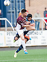 Stenny's Ciaran Summers collides with Forfar's Omar Kader.