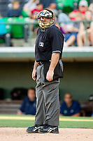 Home plate umpire Craig Barron during the International League game between the Gwinnett Braves and the Charlotte Knights at Knights Stadium on June 3, 2012 in Fort Mill, South Carolina.  The Braves defeated the Knights 5-1.  (Brian Westerholt/Four Seam Images)