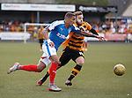 James Tavernier muscles his way past Steven Hetherington