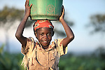 Sibongile Theghe carries water home in Ekwendeni, Malawi.