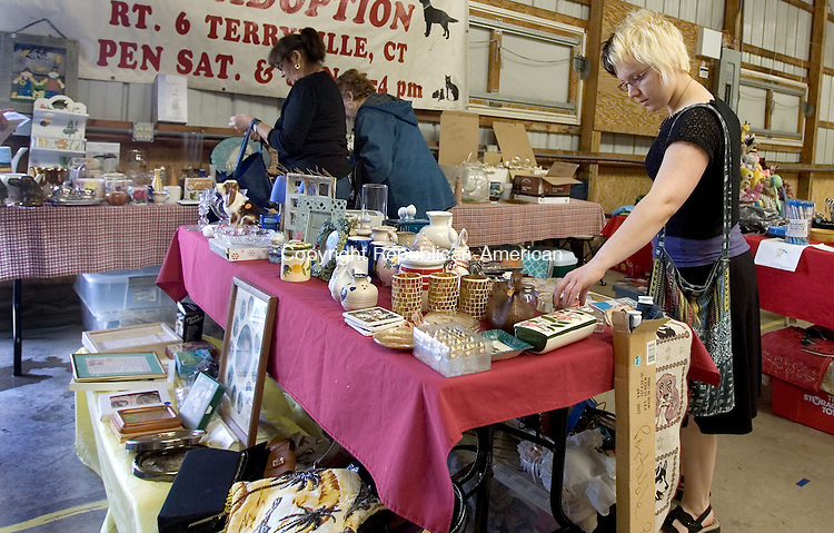 PLYMOUTH CT. 08 June 2013-060813SV11-Meghan Ferrero of Harwinton, right, shops at the 10th Annual Terryville Giant Flea Market &amp; Craft show at the Terryville Fairgrounds in Plymouth Saturday. <br /> Steven Valenti Republican-American