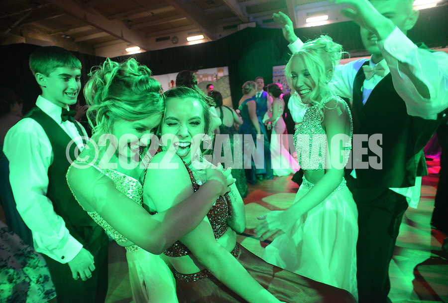 "Bathed in green light, Klaudia Kuzia (2nd from left) and Lexus Sinkiewicz (3rd from left) dance during the senior prom Saturday, May 20, 2017 at Pennsbury High School East in Fairless Hills, Pennsylvania. Pennsbury's senior prom is one of few still held at the school itself and this year featured the theme ""Yo Philly"" highlighting various features of Philadelphia. (Photo by William Thomas Cain)"