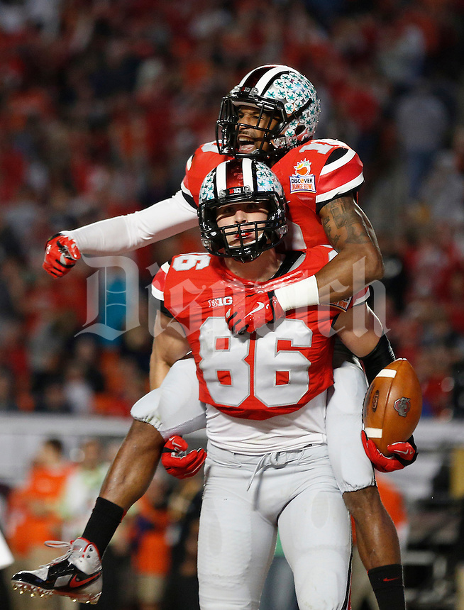 Ohio State Buckeyes wide receiver Philly Brown (10) and Ohio State Buckeyes tight end Jeff Heuerman (86) celebrate after Heuerman's touchdown in the second quarter of the Discover Orange Bowl between Ohio State and Clemson at Sun Life Stadium in Miami Gardens, Florida, Friday night, January 3, 2014. As of half time the Ohio State Buckeyes led the Clemson Tigers 22 - 20.(The Columbus Dispatch / Eamon Queeney)