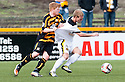 Dumbarton's Scott Agnew is held back by Alloa's Ryan McCord.