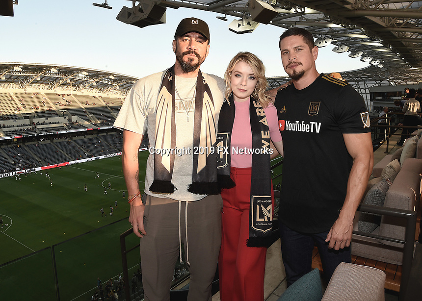 """LOS ANGELES - AUGUST 21: Clayton Cardenas, Sarah Bolger and JD Pardo at FX's """"Mayans M.C."""" Activation at Los Angeles Football Club at Banc of California Stadium on August 21, 2019 in Los Angeles, California. (Photo by Scott Kirkland/FX Networks/PictureGroup)"""