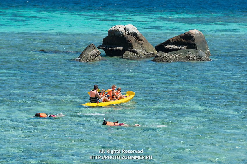 Kids snorkeling and kayaking with family in Andaman sea, Ko Lipe, Thailand