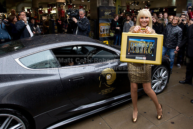 24/09/2012. LONDON, UK. Actress Britt Ekland, who played Bond Girl 'Goodnight' in 'The Man with the Golden Gun' is seen outside HMV with an Aston Martin DB5 from 'Quantum of Solice' in Oxford Street, London, today (24/09/12) during a photocall. The stars were in London during the final leg of a UK tour to promote the Bond 50 Blu-Ray collection.  Photo credit: Matt Cetti-Roberts