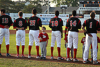 Batavia Muckdogs line up for the national anthem as a member of the Stars of the Game (LeRoy Little League) does things his own way before a game against the Auburn Doubledays at Dwyer Stadium on June 17, 2011 in Batavia, New York.  Auburn defeated Batavia in the season opener 6-1.  (Mike Janes/Four Seam Images)