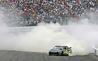 14 September 2008--Greg Biffle performs victory burnout after winning the Sylvania 300 at New Hampshire Motor Speedway in Loudon, NH.  (Brian Cleary/BCPix.com)