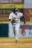 Devyn Bolasky (11) of the Charleston RiverDogs hustles towards third base against the Hickory Crawdads at L.P. Frans Stadium on August 25, 2015 in Hickory, North Carolina.  The Crawdads defeated the RiverDogs 7-4.  (Brian Westerholt/Four Seam Images)
