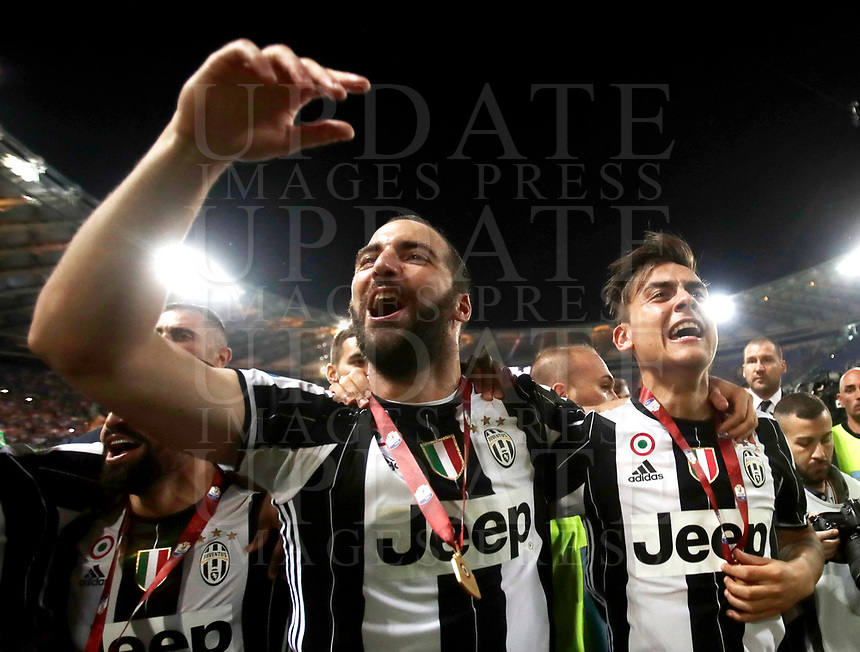 Football Soccer - Juventus - Lazio - Italian Cup Final - Olympic Stadium, Rome, Italy, May17,2017.<br /> Juventus' Gonzalo Higuain (l) and Paulo Dybala (r) celenbrate after winning the Italian Cup Final match at Rome's Olympic stadium, on May 17, 2017.<br /> UPDATE IMAGES PRESS/Isabella Bonotto