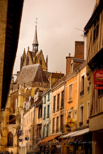 The steeple of a church is the point of attention in this cityscape taken in Ferte Benard, France