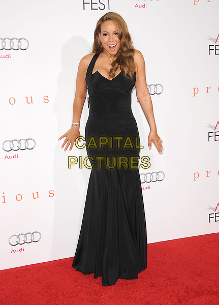 "MARIAH CAREY .The 2009 AFI Fest Screening of ""Precious"" held at The Grauman's Chinese Theatre in Hollywood, California, USA..November 1st, 2009.full length black dress long fishtail maxi gown mouth open hands .CAP/RKE/DVS.©DVS/RockinExposures/Capital Pictures"