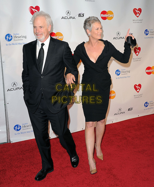 CHRISTOPHER GUEST & JAMIE LEE CURTIS .at The 2011  MusiCares Person of the Year Dinner at the Los Angeles Convention Center, West Hall in Los Angeles, California, USA, .February 11th 2011..full length black dress black dress suit tie  suit tie couple .CAP/RKE/DVS.©DVS/RockinExposures/Capital Pictures.