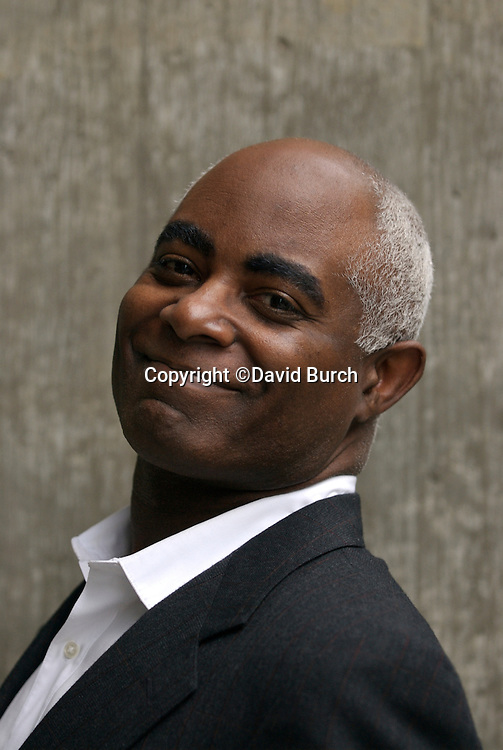 African American man in business suit without tie smiling
