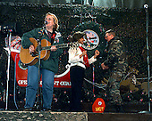 Country music star Mary Chapin Carpenter performs for the Task Force Eagle soldiers while Janet Cohen dances with a soldier at the 21 Club on Eagle Base Tuzla Main, Bosnia and Herzegovina, on Christmas Eve, December 24, 1997.  Carpenter is on a tour overseas sponsored by the USO.  Cohen is visiting soldiers for the holidays with her husband United States Secretary of Defense William S. Cohen (not pictured).  .Mandatory Credit: Richard L. Branham / U.S. Army via CNP
