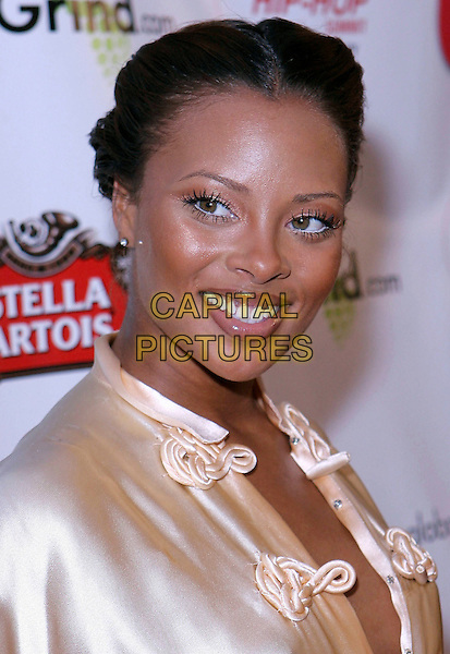 EVA MARCILLE PIGFORD.Russell Simmons and US Magazine host 2009 Grammy Awards Post Party at a Private Residence, Beverly Hills, California, USA..February 8th, 2009.headshot portrait white eyeliner gold silk satin cream pink.CAP/ADM/TC.©T. Conrad/AdMedia/Capital Pictures.