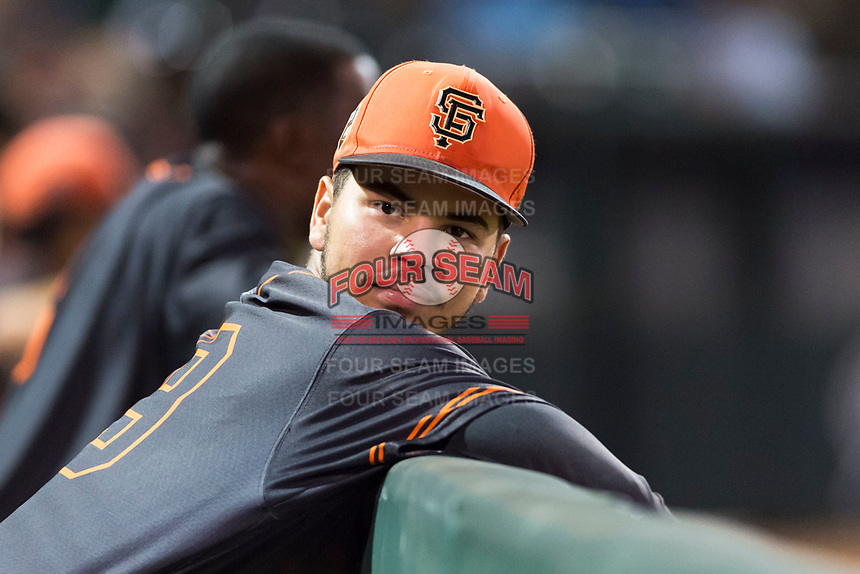 AZL Giants Black Francisco Medina (19) in the dugout during an Arizona League game against the AZL Rangers at Scottsdale Stadium on August 4, 2018 in Scottsdale, Arizona. The AZL Giants Black defeated the AZL Rangers by a score of 6-3 in the second game of a doubleheader. (Zachary Lucy/Four Seam Images)