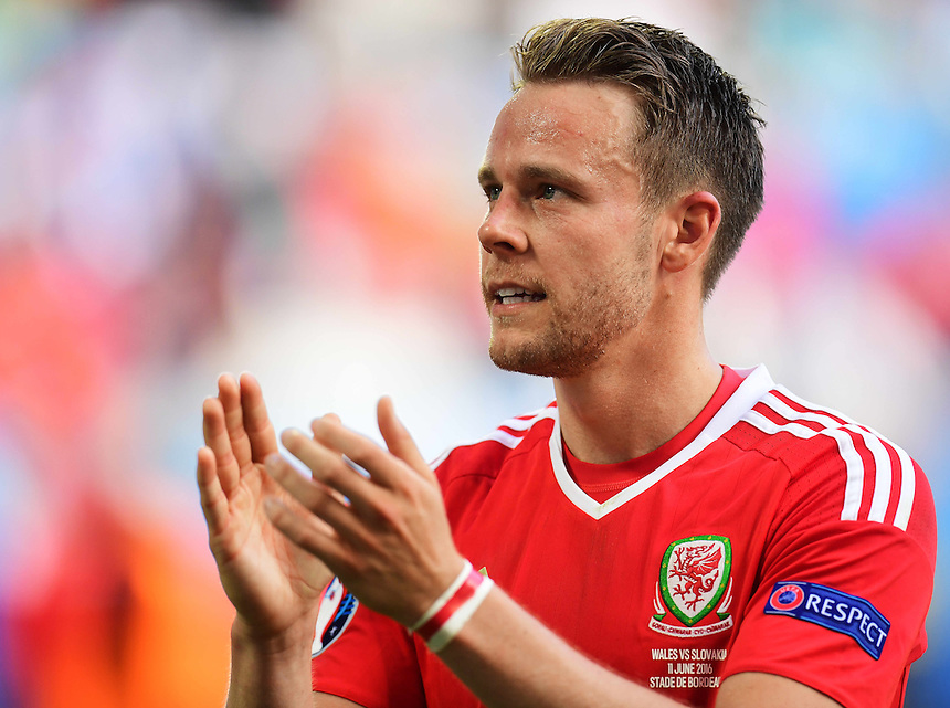 Wales's Chris Gunter applauds sides fans following their 2-1 victory over Slovakia<br /> <br /> Photographer Kevin Barnes/CameraSport<br /> <br /> International Football - 2016 UEFA European Championship - Group B - Wales v Slovakia - Saturday 11th June 2016 - Nouveau Stade de Bordeaux, Bordeaux<br /> <br /> World Copyright &copy; 2016 CameraSport. All rights reserved. 43 Linden Ave. Countesthorpe. Leicester. England. LE8 5PG - Tel: +44 (0) 116 277 4147 - admin@camerasport.com - www.camerasport.com