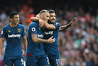 West Ham United's Marko Arnautovic celebrates scoring his side's first goal with Robert Snodgrass<br /> <br /> Photographer Rob Newell/CameraSport<br /> <br /> The Premier League - Arsenal v West Ham United - Saturday August 25th 2018 - The Emirates - London<br /> <br /> World Copyright © 2018 CameraSport. All rights reserved. 43 Linden Ave. Countesthorpe. Leicester. England. LE8 5PG - Tel: +44 (0) 116 277 4147 - admin@camerasport.com - www.camerasport.com