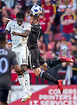 Real Salt Lake midfielder Nick Besler (13) heads the ball away from Colorado Rapids forward Dominique Badji (14) in the first half Saturday, April 21, 2018, during the Major League Soccer game at Rio Tiinto Stadium in Sandy, Utah. RSL beat the Colorado Rapids 3-0. (© 2018 Douglas C. Pizac)