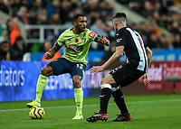 9th November 2019; St James Park, Newcastle, Tyne and Wear, England; English Premier League Football, Newcastle United versus AFC Bournemouth; Callum Wilson of AFC Bournemouth controls the ball with Ciaran Clark of Newcastle United close by - Strictly Editorial Use Only. No use with unauthorized audio, video, data, fixture lists, club/league logos or 'live' services. Online in-match use limited to 120 images, no video emulation. No use in betting, games or single club/league/player publications