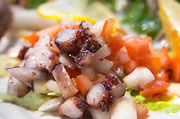 Salad with calamares calamari, octopus, ink fish and vegetables. Hotel and restaurant Kompas. Uvala Sumartin bay between Babin Kuk and Lapad peninsulas. Dubrovnik, new city. Dalmatian Coast, Croatia, Europe.