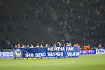 The home team players unfurling a banner thanking their fans after Hertha Berlin have defeated Sporting Lisbon in the Olympic Stadium in Berlin in a UEFA Europa League group match. Hertha won the match by 1 goal to nil to press to the knock-out round of the cup. 2009/10 was the the first year in which the Europa League replaced the UEFA Cup in European football competition.