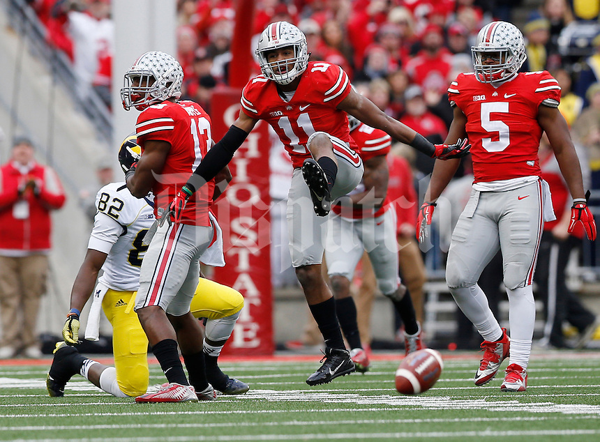 Ohio State Buckeyes defensive back Vonn Bell (11) celebrates an incomplete pass to Michigan Wolverines wide receiver Amara Darboh (82) during the 4th quarter of the NCAA football game at Ohio Stadium on Nov. 29, 2014. (Adam Cairns / The Columbus Dispatch)