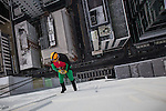© Joel Goodman - 07973 332324 . 7 December 2013 . Robin ( JOHN BENTLEY , a 51 year old lift engineer from Woodhouses in Oldham - correct ) starts his descent . In scenes reminiscent of a Fathers for Justice demonstration , people in superhero and Christmas-themed costumes , abseil 107 metres down the New York Street side of City Tower to raise money for the Factory Youth Zone in Harpurhey . Photo credit : Joel Goodman