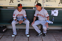 OAKLAND, CA - JUNE 19:  Emmanuel Burriss #2 and coach Tim Flannery #1 of the San Francisco Giants talk in the dugout before the game against the Oakland Athletics at the Oakland-Alameda County Coliseum on June 19, 2011 in Oakland, California. Photo by Brad Mangin