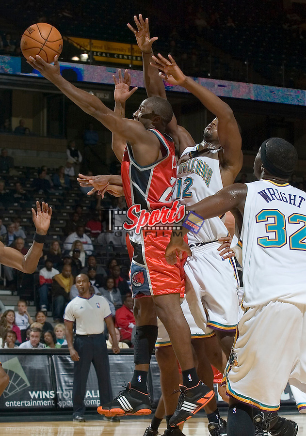 Charlotte Bobcats guard Raymond Felton (20) drives to the basket during second half action versus the New Orleans Hornets at the LJVM Coliseum in Winston-Salem, NC, Friday, October 26, 2007.