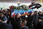 © Joel Goodman - 07973 332324 . No syndication permitted . 11/11/2012 . Lytham Park Crematorium , UK . The coffin is carried from the hearse . Hundreds of strangers at the funeral of World War Two veteran Harold Jellicoe Percival today (Monday 11th November 2013) . The funeral is timed to coincide with the First World War armistice , the 95th anniversary of which is at 11am today (Monday 11th November 2013) . The RAF Bomber Command veteran died in his sleep on 25th October 2013 , aged 99 , at Alistre Lodge Nursing Home in St Annes , Lancashire , with no immediate family . Photo credit : Joel Goodman