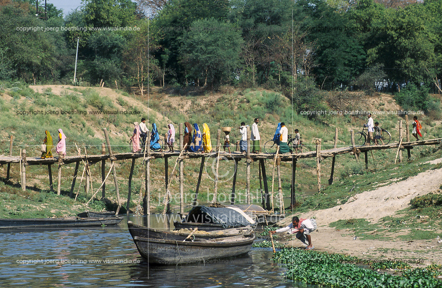 INDIA, Benares Varanasi,<br /> people crossing a small bamboo timber bridge near river Ganga