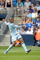 Kansas City forward Teal Bunbury (9) has a shot on goal... Sporting Kansas City defeated San Jose Earthquakes 2-1 at LIVESTRONG Sporting Park, Kansas City, Kansas.
