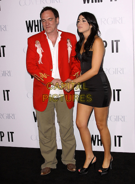 "QUENTIN TARANTINO & GUEST .Attending the ""Whip It"" Los Angeles Premiere held At Grauman's Chinese Theatre, Hollywood, California, USA, 29th September 2009..full length red jacket black dress green khaki trousers white shirt naked lady .CAP/ADM/KB.©Kevan Brooks/AdMedia/Capital Pictures."