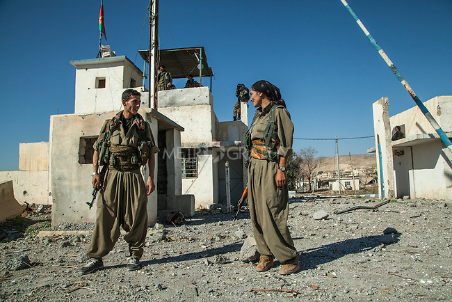 13/11/2015-- Iraq,Sinjar -- YPG fighters in front of the police building which had been controlled after liberating Sinjar.