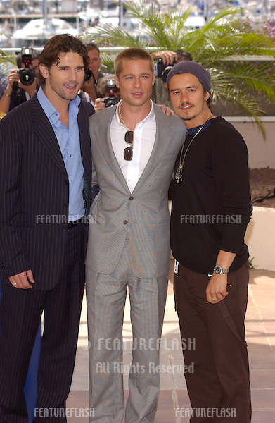 BRAD PITT (in grey), ORLANDO BLOOM (with hat) & ERIC BANA at the photocall for their new movie Troy at the Cannes Film Festival, Cannes, France..May 13, 2004
