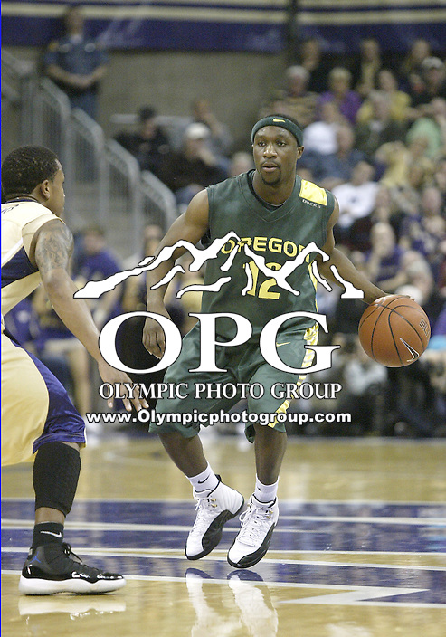02 January 2010:  Oregon guard #12 Tajuan Porter brings the ball down court against Washington. Oregon won 90-79 over  Washington at the Bank of America Arena in Seattle, WA.