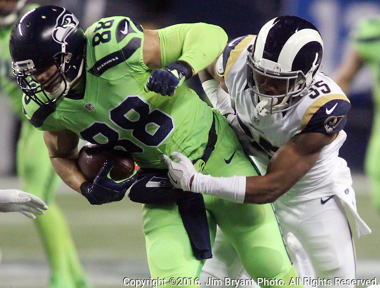 Seattle Seahawks tight end Jimmy Graham (88) fights through the tackles of Los Angeles Rams defensive back Michael Jordan (35)  after catching a 31-yard pass from quarterback Russell Wilson to set up a 1-yard touchdown at CenturyLink Field in Seattle, Washington on December 15, 2016.  The Seahawks beat the Rams 24-3.   ©2016. Jim Bryant Photo. All Rights Reserved