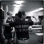 Miami, Florida. Some good natured  hootin before the game in the locker room with the women of the Miami Fury professional football team.