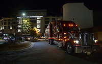NWA Democrat-Gazette/ANDY SHUPE<br />A semi-truck and trailer leaves Razorback Stadium Thursday, Nov. 9, 2017, before heading out to Baton Rouge, La., ahead of the Razorbacks' game with LSU Saturday. Jerry Rico of Fayetteville and Rodney Collins of Pensacola, Fla., are employees of J.B. Hunt Transport and the work together to drive equipment necessary for the Razorbacks football team to and from games away from Fayetteville.