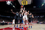 Wisconsin Badgers guard Traevon Jackson (12) shoots over 3 defenders during an NCAA  college basketball game against the Presbyterian Blue Hose Tuesday, November 20, 2012 in Madison, Wis. The Badgers won 88-43. (Photo by David Stluka)