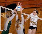 SPEARFISH, SD - NOVEMBER 2, 2013:  Alanna Winfield #2 of Colorado Mines hits into the blocking hands of Meghan Sipe #12 and Shelby Mayer #13 of Black Hills State during their game Saturday at the Donaldo E. Young Center in Spearfish, S.D.  (Photo by Dick Carlson/Inertia)