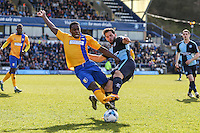 Sam Wood of Wycombe Wanderers (right) is injured in thechallenge by Mitch Rose of Mansfield Town (left) during the Sky Bet League 2 match between Wycombe Wanderers and Mansfield Town at Adams Park, High Wycombe, England on 25 March 2016. Photo by David Horn.