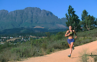 FEB 1999 - STELLENBOSCH, SOUTH AFRICA - South African triathlete Annelle Rabie running in the hills above the university. (PHOTO (C) NIGEL FARROW)