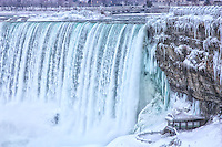 An icy and wintery view of the Canadian falls in Niagara.